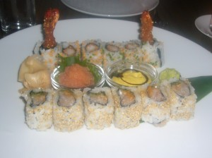 Sesame Crusted Shrimp Roll, orange curry dressing & reduced balsamic vinegar