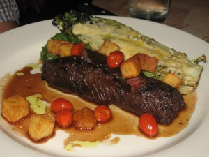 Sangria Marinated Hangar Steak, grilled romaine ala caesar, burst tomatoes